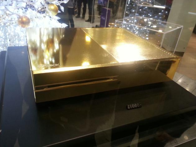 Foto da xbox one em ouro